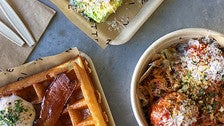 Waffle with bacon and poached egg, Caesar salad, spaghetti and meatballs at Dinette